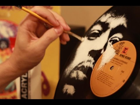 Hand-painted portraits of famous musicians, on vinyl records