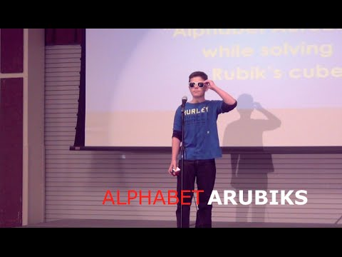 Kid solves Rubik's Cube while rapping Alphabet Aerobics
