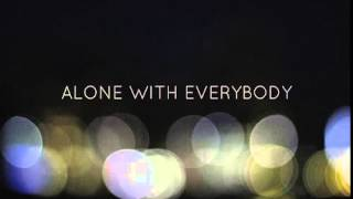 Alone with everybody    in a safe place    somewhere near your heart
