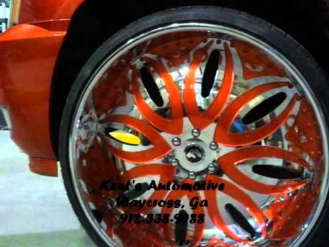 Candy Tangerine Cadillac Escalade on 30 inch Forgiatos (Kent's Automotive)
