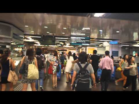 Walking inside and out of City Hall MRT station, Singapore