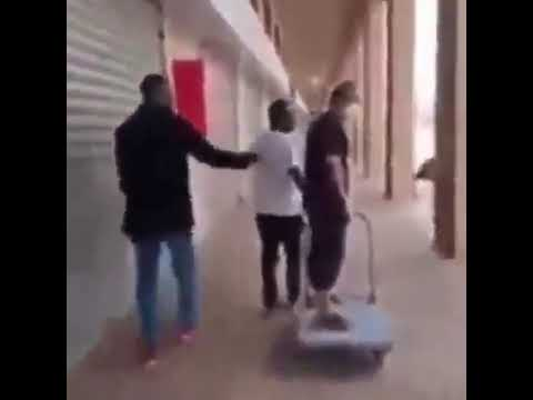 China man order African to pull him with Trolley