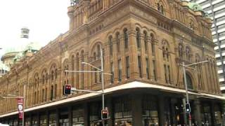Sydney - Busy Crossroad Intersection At Qvb Shopping Centre Queen Victoria Building