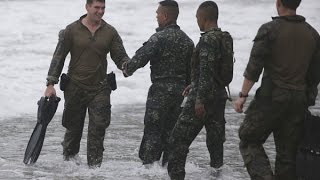 U.S. Marine held after death of transgender woman in the Philippines | 14th October 2014