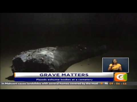 Floods exhume bodies at a cemetery