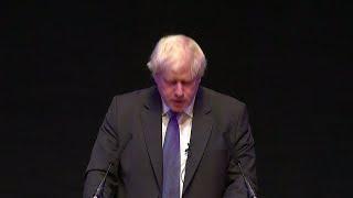 Boris Johnson slams Theresa May's Brexit plan at fractious Tory meeting
