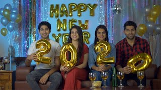 Group of young beautiful people showing golden 2020 celebration balloons - New Year Eve
