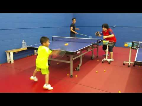 ping pong table tennis 6 years old boy in practice