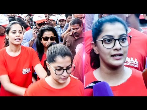 Varalaxmi leads a campaign for violence against women | Walk a mile in her shoes