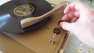 Symphonic manual 3 speed record player playing a 78 RPM record.