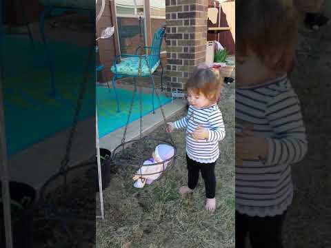 Emmy swinging her baby