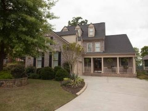 Live on the Prestigious Woodmont Golf & Country Club at 116 Ridgemoor Trace Canton, GA 30115