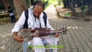 Rubab Instrument played by a Pakistani man at Daman-e-Koh garden