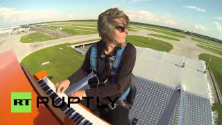 "Germany: Watch this pianist play a mid-air ""magic carpet"" show over Munich Airport"