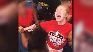 Cheerleader Screams As Teammates Force Her Into Split (VIDEO)