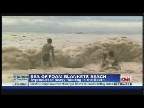 Australian sea foam blankets beach (January 29, 2013)