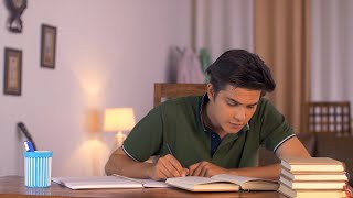 Indian teenager studying hard for his upcoming semester exams - education concept