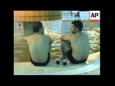 Iranians flock to a hot springs spa