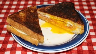 Grilled Ham Egg And Cheese Breakfast Sandwich On The Cast Iron Griddle