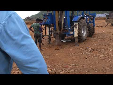 Solar piles drilling  with tractor
