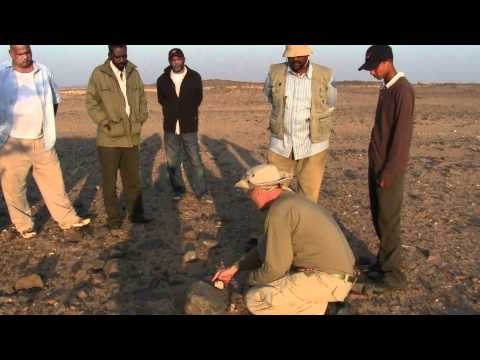 Explaining the Geology of contact zones in Gold Prospecting with Arabic translation