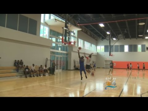 Kids & Cops Bond On Basketball Court For Charity Youth Event