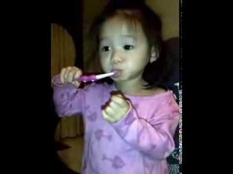Baby Brushing teeth along with Elmo's song