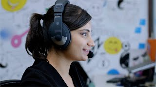 Attractive Indian woman attending a customer complaint call at the call center