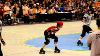 WFTDA Uproar on the Lakeshore: Suzy Hotrod jamming for Gotham