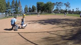 12u fastpitch softball player hits 2 out of the park home runs in the same game.