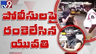 Woman abuses traffic police in Hyderabad - TV9
