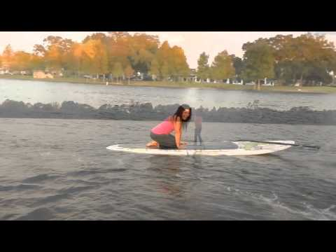 SUP Fail.  Paddle board Yoga teacher handstand to fall