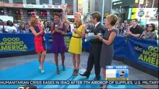 Ginger Zee - shark week high heels & colorful dress