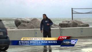 Gusty wind causes huge waves off Lake Michigan