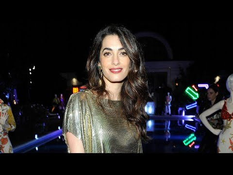 Amal Clooney Glimmers in Metallic Dress For a Rare Ladies Night Out With Isla Fisher