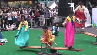 Seoul, South Korea - Buddhist Street Festival - Neolttwigi seesaw game