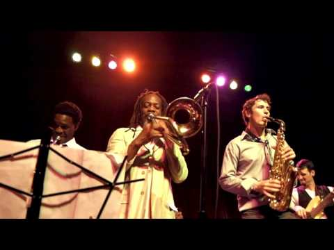 Tim Watson plays reggae with horn section.
