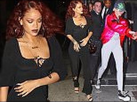 Rihanna cuts a demure figure in black jumpsuit as she parties the night away with fellow wild child
