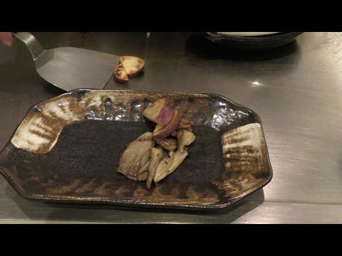 Top chef cooking at Teppanyaki Restaurant Sazanka