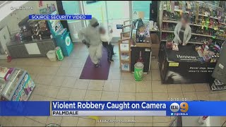 Caught On Tape: Violent Liquor Store Robbery With Suspect Dragging Victim Around