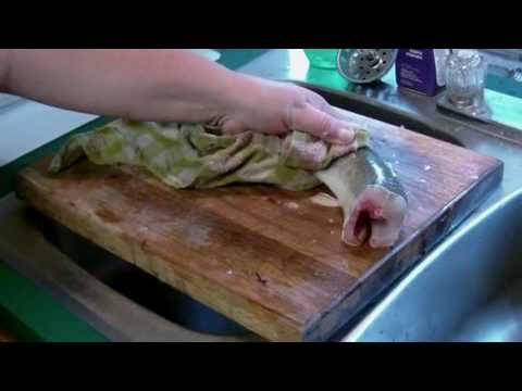 A Dead Fish Carcass Flails Around On A Cutting Board