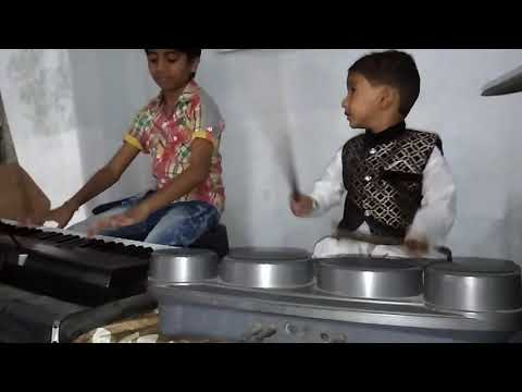 2 years old boy playing drum pad