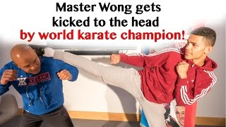 Master Wong gets kicked to the head by world karate champion