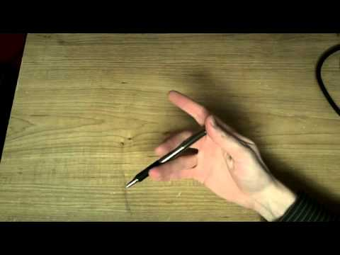 How To Spin A Pen Around Your Fingers Youtube