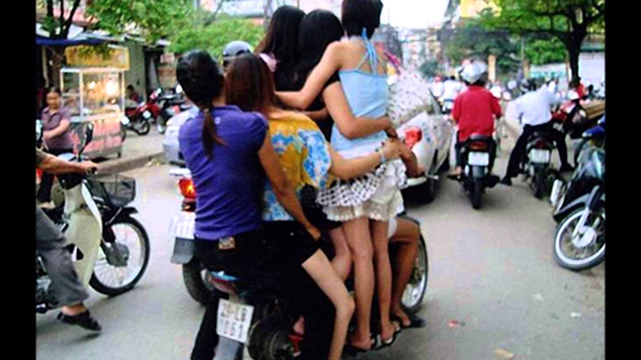 6 girls riding on a single bike together.