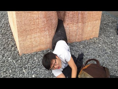 Man stuck inside ATM slips notes for help; Student gets stuck in a statue in Germany - Compilation