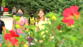 students and flowers on campus