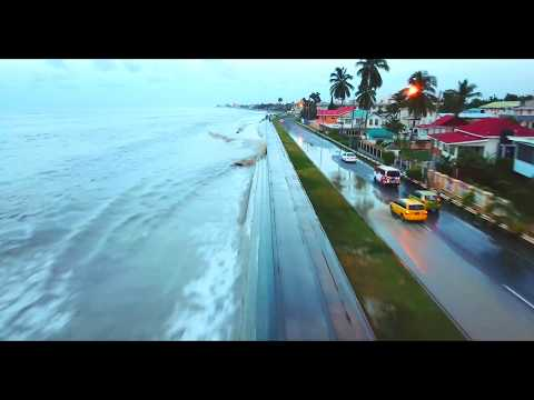 THE ATLANTIC OCEAN THREATENS GUYANA'S COAST. WAVES OVER TOPPING THE SEAWALL