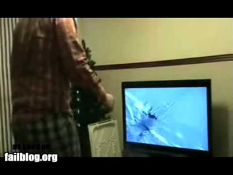 guy breaking tv with wii remote!! LOL!!