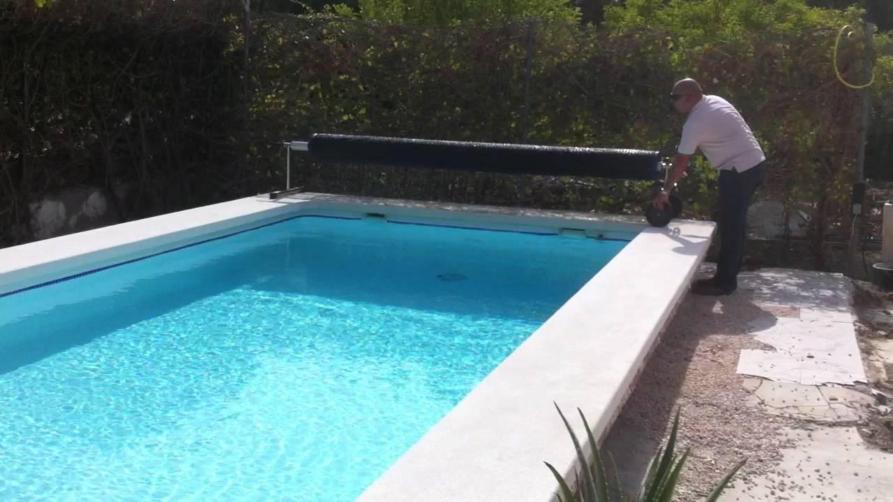 Recoger cobertor con enrollador youtube for Como hacer un cubre piscinas